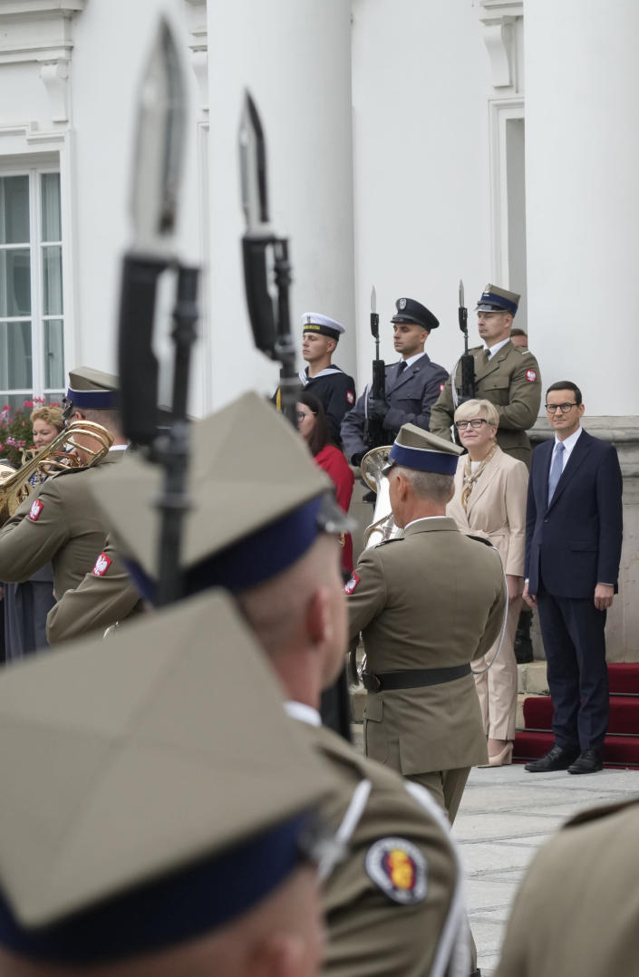 Lithuanian Prime Minister Ingrida Simonyte, second right, being greeted by Poland's Prime Minister Mateusz Morawiecki on a visit for talks that include the region's security in the face of migrant pressure on the two countries' borders with Belarus, in Warsaw, Poland, on Friday, Sept. 17, 2021. (AP Photo/Czarek Sokolowski)