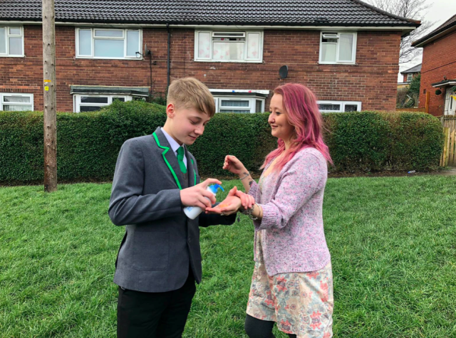 Oliver Cooper, pictured with mum Jenny Tompkins, was reportedly sent home from school for selling hand sanitiser. (SWNS)