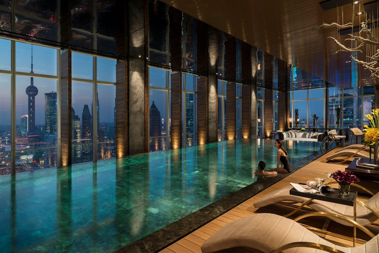 If you're visiting Shanghai, a trip to the <strong>Four Seasons Hotel Pudong</strong> hotel is a must. Perched high in the sky, guests will enjoy jaw-dropping views of the city's downtown, while relaxing in the hotel's infinity pool.