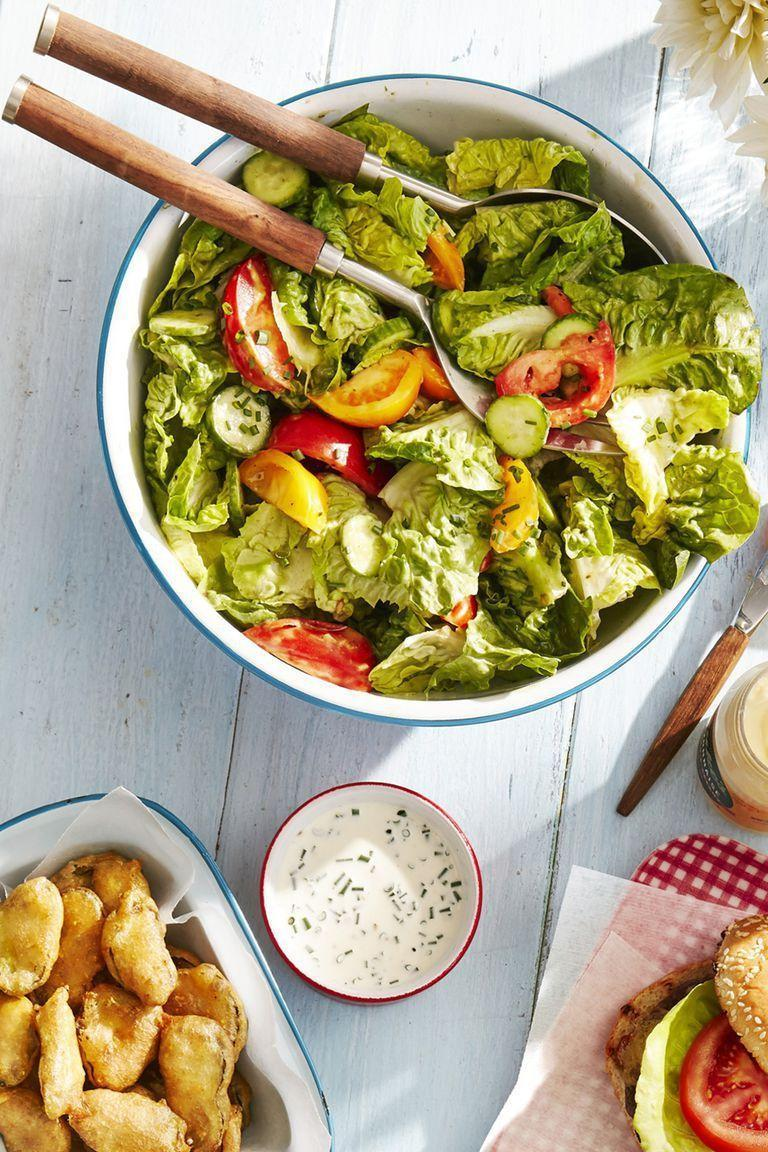 "<p>A fresh, crunchy salad is all but necessary during a Labor Day cookout. This one fills the bill nicely.</p><p><strong><a href=""https://www.countryliving.com/food-drinks/a28188449/tossed-salad-with-green-goddess-dressing-recipe/"" rel=""nofollow noopener"" target=""_blank"" data-ylk=""slk:Get the recipe"" class=""link rapid-noclick-resp"">Get the recipe</a>.</strong></p><p><a class=""link rapid-noclick-resp"" href=""https://www.amazon.com/Lipper-International-1188-Acacia-Servers/dp/B008EQAMNC?tag=syn-yahoo-20&ascsubtag=%5Bartid%7C10050.g.3663%5Bsrc%7Cyahoo-us"" rel=""nofollow noopener"" target=""_blank"" data-ylk=""slk:SHOP SALAD SERVERS"">SHOP SALAD SERVERS</a></p>"