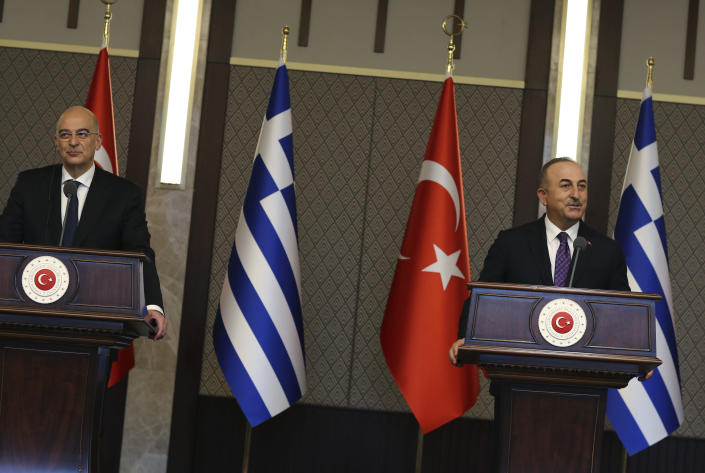 Turkish Foreign Minister Mevlut Cavusoglu, right, talks during a joint media statement with Greek Foreign Minister Nikos Dendias, following their meeting in Ankara, Turkey, Thursday, April 15, 2021. Greece's foreign minister is in Ankara Thursday for talks on the two NATO allies' fraught relationship, following a slight easing of tensions between the neighbors.The visit is the first between the two nations following a tumultuous year.(AP Photo/Burhan Ozbilici)