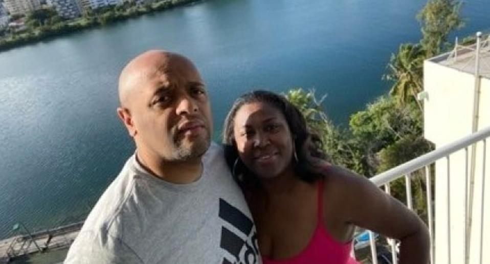 Jamar and Ann Marie Robinson pose in selfie by the water.