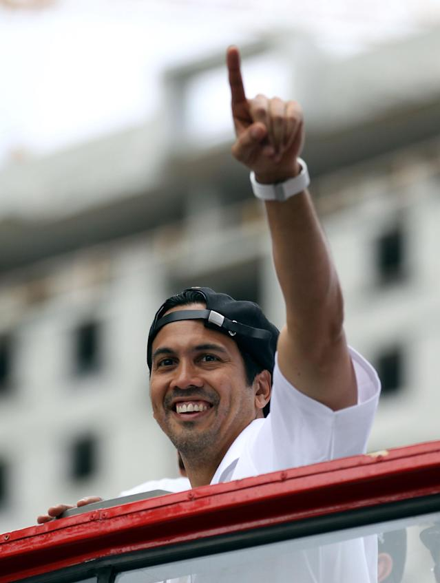 MIAMI, FL - JUNE 24: Head Coach Erik Spoelstra of the Miami Heat gestures as he rides a float during the Championship victory parade on the streets on June 24, 2013 in Miami, Florida. The Miami Heat defeated the San Antonio Spurs in the NBA Finals. (Photo by Marc Serota/Getty Images)