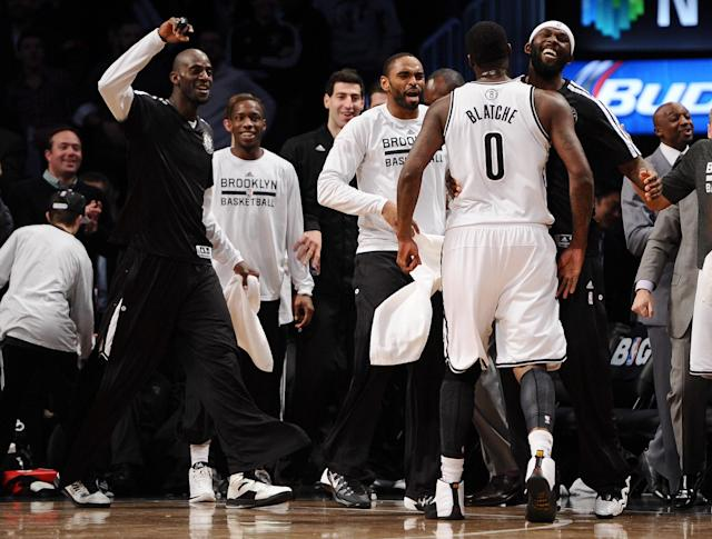 NEW YORK, NY - DECEMBER 12: Andray Blatche #0 of the Brooklyn Nets celebrates with Reggie Evans #30 after scoring a three point basket at the end of the third quarter against the Los Angeles Clippers at Barclays Center on December 12, 2013 in the Brooklyn borough of New York City. The Nets defeat the Clippers 102-93. (Photo by Maddie Meyer/Getty Images)