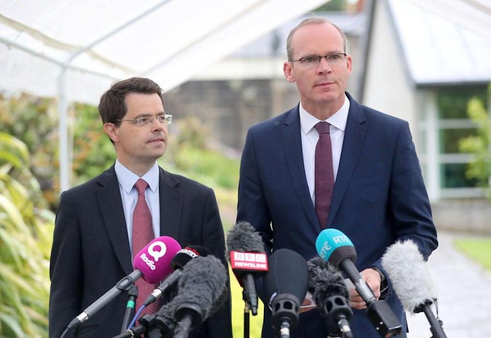 James Brokenshire with Irish Foreign Affairs Minister Simon Coveney (Niall Carson/PA) (PA Archive)