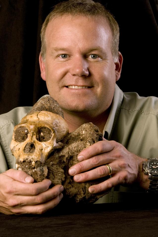 This image released by the journal Science shows Lee R. Berger of the University of Witwatersrand in South Africa holding the cranium of Australopithecus sediba. A detailed analysis of 2 million-year-old bones found in South Africa offers the most powerful case so far in identifying the transitional figure that came before modern humans, findings some are calling a potential game-changer in understanding evolution. (AP Photo/Courtesy of Lee Berger and the University of Witwatersrand)