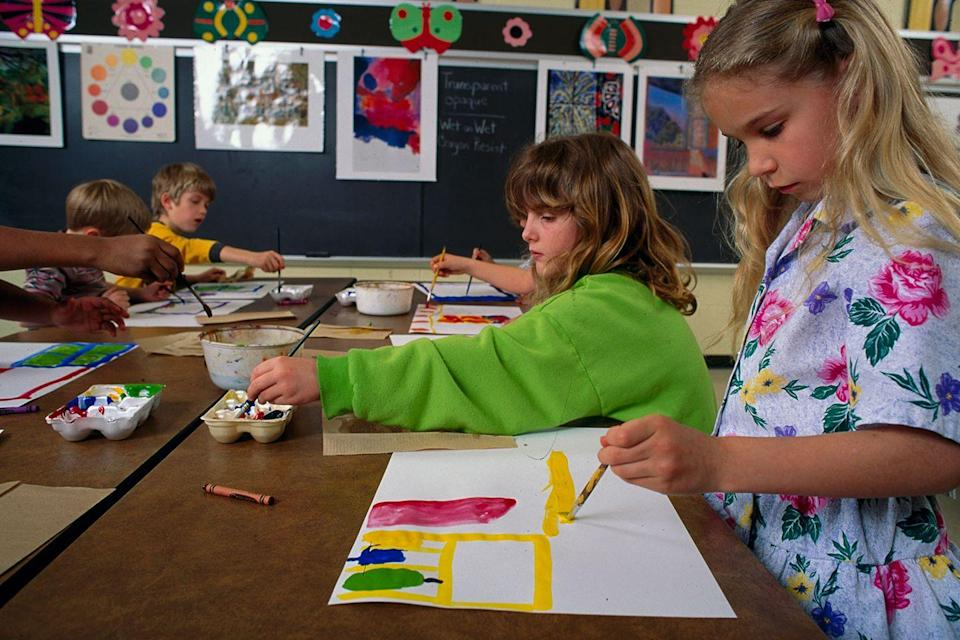 <p>First grade students get some painting done during art class.</p>