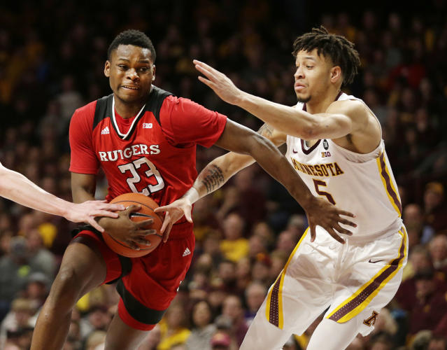Rutgers guard Montez Mathis (23) drives on Minnesota guard Amir Coffey (5) during the second half of an NCAA college basketball game Saturday, Jan. 12, 2019, in Minneapolis. Minnesota defeated Rutgers 88-70. (AP Photo/Andy Clayton-King)