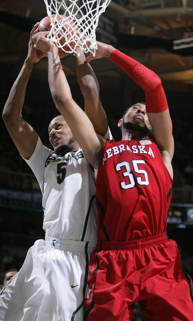 Michigan State's Adreian Payne (5) and Nebraska's Walter Pitchford (35) fight for a rebound during the first half of an NCAA college basketball game on Sunday, Feb. 16, 2014, in East Lansing, Mich. (AP Photo/Al Goldis)