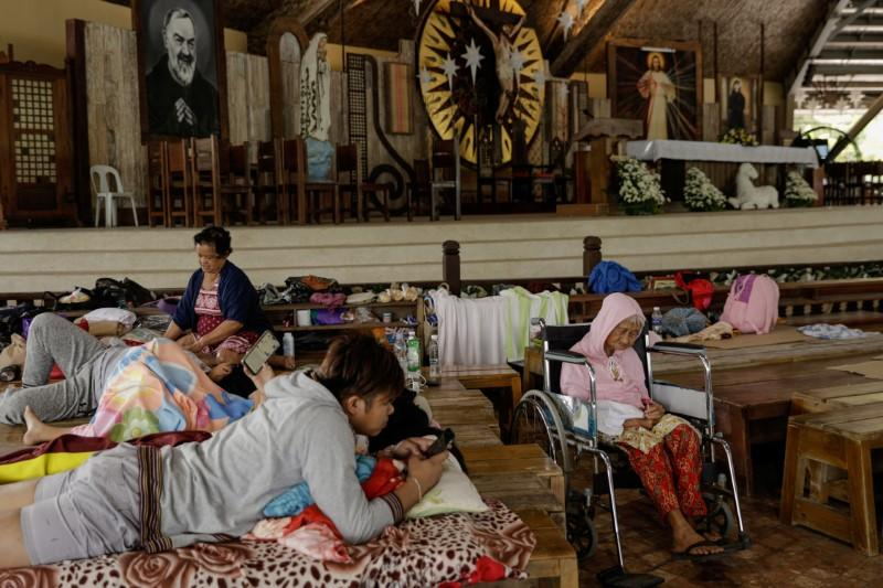 Residents affected by the Taal Volcano eruption rest in Padre Pio Shrine