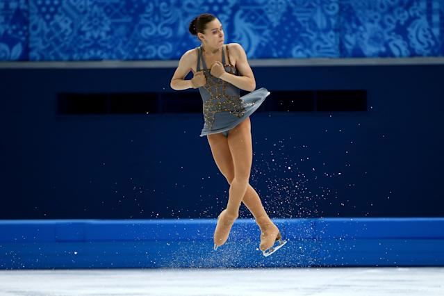 SOCHI, RUSSIA - FEBRUARY 20: Adelina Sotnikova of Russia competes in the Figure Skating Ladies' Free Skating on day 13 of the Sochi 2014 Winter Olympics at Iceberg Skating Palace on February 20, 2014 in Sochi, Russia. (Photo by Ryan Pierse/Getty Images)