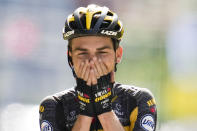 Sepp Kuss of the US celebrates as he crosses the finish line to win the fifteenth stage of the Tour de France cycling race over 191.3 kilometers (118.9 miles) with start in Ceret and finish in Andorra-la-Vella, Andorra, Sunday, July 11, 2021. (AP Photo/Christophe Ena)