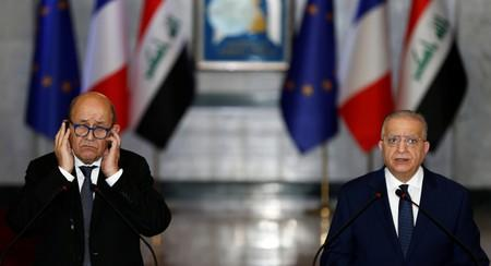 French Foreign Minister Jean-Yves Le Drian speaks during a news conference with Iraqi Foreign Minister Mohamed Ali Alhakim at the Ministry of Foreign Affairs in Baghdad