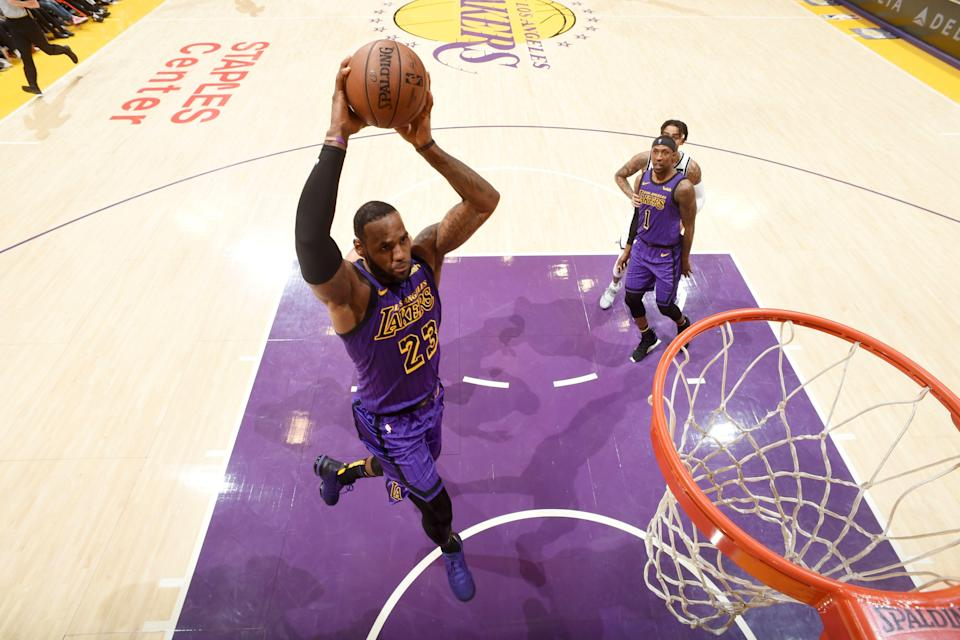 LOS ANGELES, CA - MARCH 22: LeBron James #23 of the Los Angeles Lakers dunks the ball against the Brooklyn Nets on March 22, 2019 at STAPLES Center in Los Angeles, California. NOTE TO USER: User expressly acknowledges and agrees that, by downloading and/or using this Photograph, user is consenting to the terms and conditions of the Getty Images License Agreement. Mandatory Copyright Notice: Copyright 2019 NBAE (Photo by Andrew D. Bernstein/NBAE via Getty Images)
