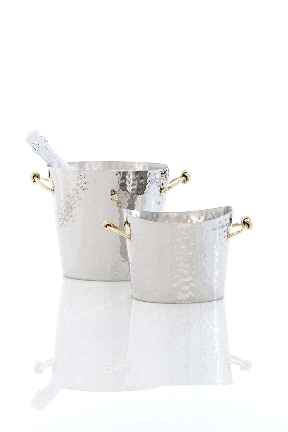 """<p>The brass handles of this ice bucket are coiled together, and it's the classiest – and least cheesy — nod we've seen to """"tying the knot"""" gifts.</p><p><strong><em>BUY IT NOW: Shiraleah Large Eternity Ice Bucket, $74; </em></strong><strong><em><a href=""""https://www.amazon.com/Shiraleah-6-5-Eternity-Bucket-Large/dp/B00XBQ2KHQ/ref=sr_1_5?s=home-garden&ie=UTF8&qid=1506962072&sr=1-5&keywords=shiraleah+eternity&tag=syn-yahoo-20&ascsubtag=%5Bartid%7C10063.g.35536497%5Bsrc%7Cyahoo-us"""" rel=""""nofollow noopener"""" target=""""_blank"""" data-ylk=""""slk:Amazon.com"""" class=""""link rapid-noclick-resp"""">Amazon.com</a></em></strong></p>"""