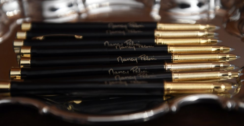 Each pen was emblazoned with Pelosi's name printed in gold. Source: Associated Press