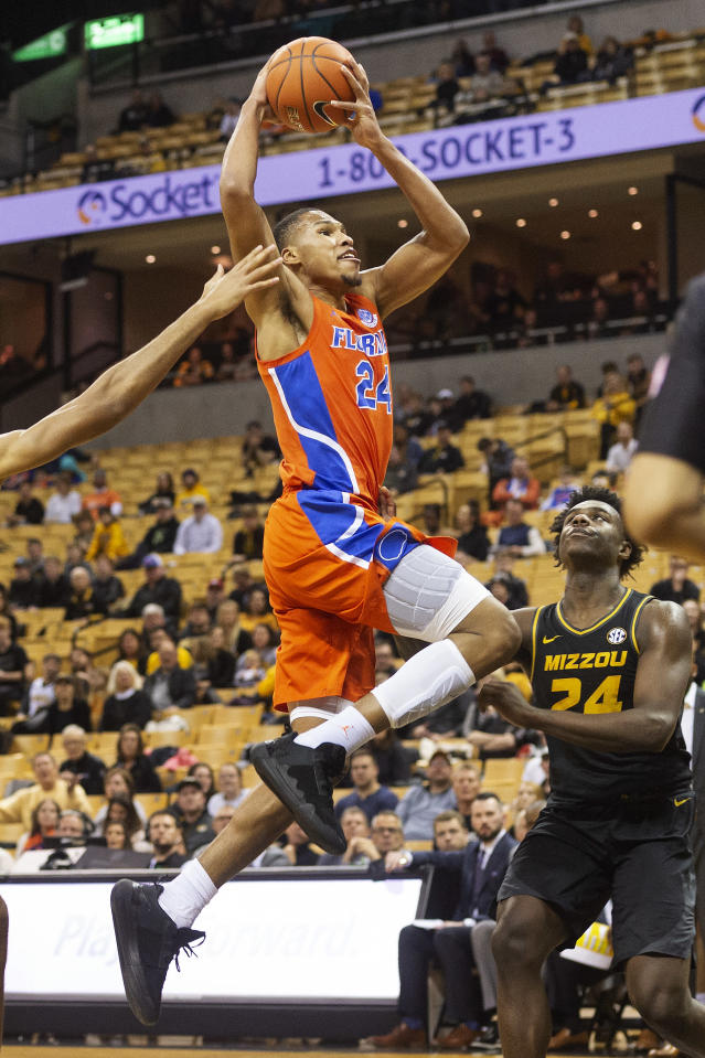 Florida's Kerry Blackshear Jr., left, shoots over Missouri's Kobe Brown, right, during the first half of an NCAA college basketball game Saturday, Jan. 11, 2020, in Columbia, Mo. (AP Photo/L.G. Patterson)