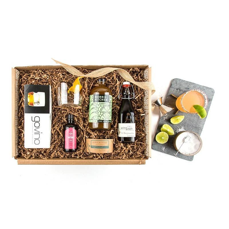 "Your winter getaway might be on hold, but this tequila cocktail kit will keep you warm as you snuggle on the couch bingeing <em>Planet Earth, Jungles.</em> $92, Mouth. <a href=""https://www.mouth.com/products/just-add-tequila-gift-box#variant=12556419137570"" rel=""nofollow noopener"" target=""_blank"" data-ylk=""slk:Get it now!"" class=""link rapid-noclick-resp"">Get it now!</a>"