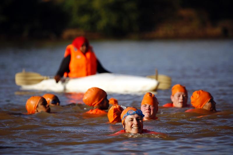 Sudanese and Dutch women take part in an event to swim across the Blue Nile in the capital Khartoum on November 21, 2015, as part of an event organised by Dutch ambassador Susan Blankhart