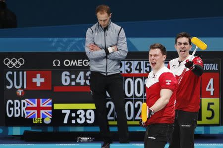 Curling - Pyeongchang 2018 Winter Olympics - Men's Tie-Breaker - Switzerland v Britain - Gangneung Curling Center - Gangneung, South Korea - February 22, 2018 - Claudio Patz and Peter de Cruz of Switzerland react next to Thomas Muirhead of Britain. REUTERS/Cathal McNaughton