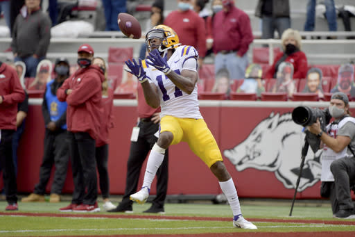 LSU receiver Racey McMath makes a catch for a touchdown against Arkansas during the first half of an NCAA college football game Saturday, Nov. 21, 2020, in Fayetteville, Ark. (AP Photo/Michael Woods)