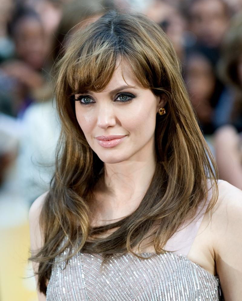 Jolie wore soft, full bangs at the Salt premiere in London, England, August 2010. Photo by Samir Hussein/Getty Images.