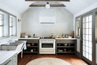 <p>Instead of opting for a narrow runner in the kitchen, bring in a round jute rug to warm things up. This shape will work especially well in an open kitchen without a rectangular island breaking up the space. </p>