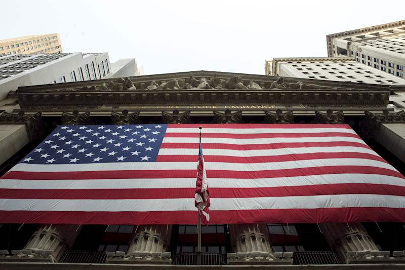 A large U.S. flag hangs on the facade of the New York Stock Exchange in New York September 3, 2015. REUTERS/Lucas Jackson