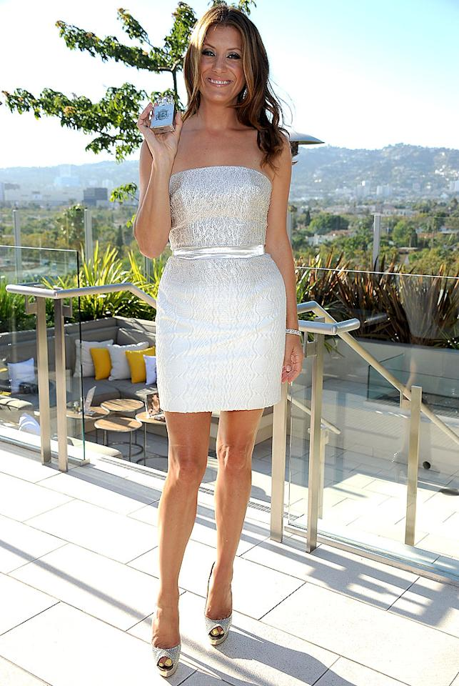 "We're on the fence with this one. Does Kate Walsh (""Private Practice"") look beautiful or boxy in the sparkly Christian Cota dress and Jimmy Choo platform peep-toes she wore to her recent fragrance launch in Beverly Hills? We're leaning towards beautiful. Discuss! (7/9/2012)"