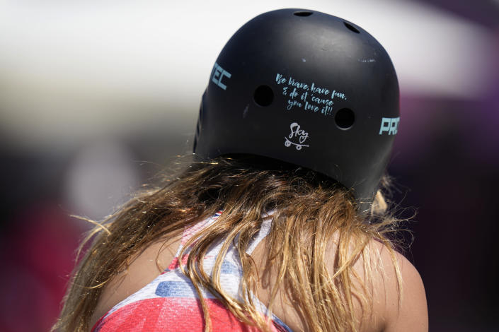 A message is written on Sky Brown of Britain helmet as she warms up for the women's park skateboarding finals at the 2020 Summer Olympics, Wednesday, Aug. 4, 2021, in Tokyo, Japan. (AP Photo/Ben Curtis)