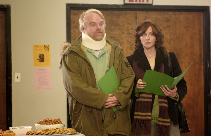 """File-This undated handout photo provided by Twentieth Century Fox shows Philip Seymour Hoffman, left, and Laura Linney in a scene from """"The Savages."""" In a medium (movies) that prizes glamour and flash, he offered the opposite: untidy, imperfect, shy, awkward and eminently real people. Despite his outsized talent, he was relentlessly humble. Bennett Miller, his longtime friend and """"Capote"""" director, once called him """"a shaman-like actor."""" (AP Photo/Twentieth Century Fox, File)"""