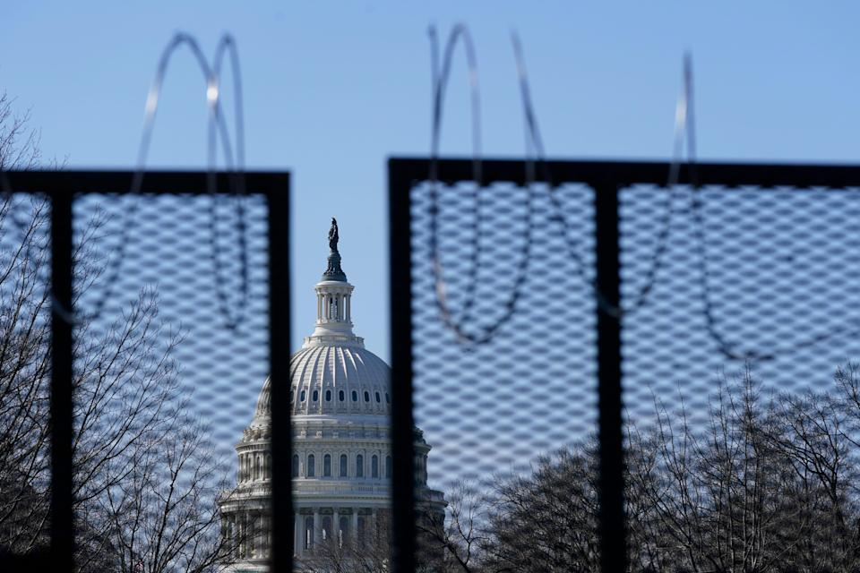 A security fence with partially removed razor wire stands on the U.S. Capitol grounds March 20, 2021, in the wake of the Jan. 6 attack on the building.
