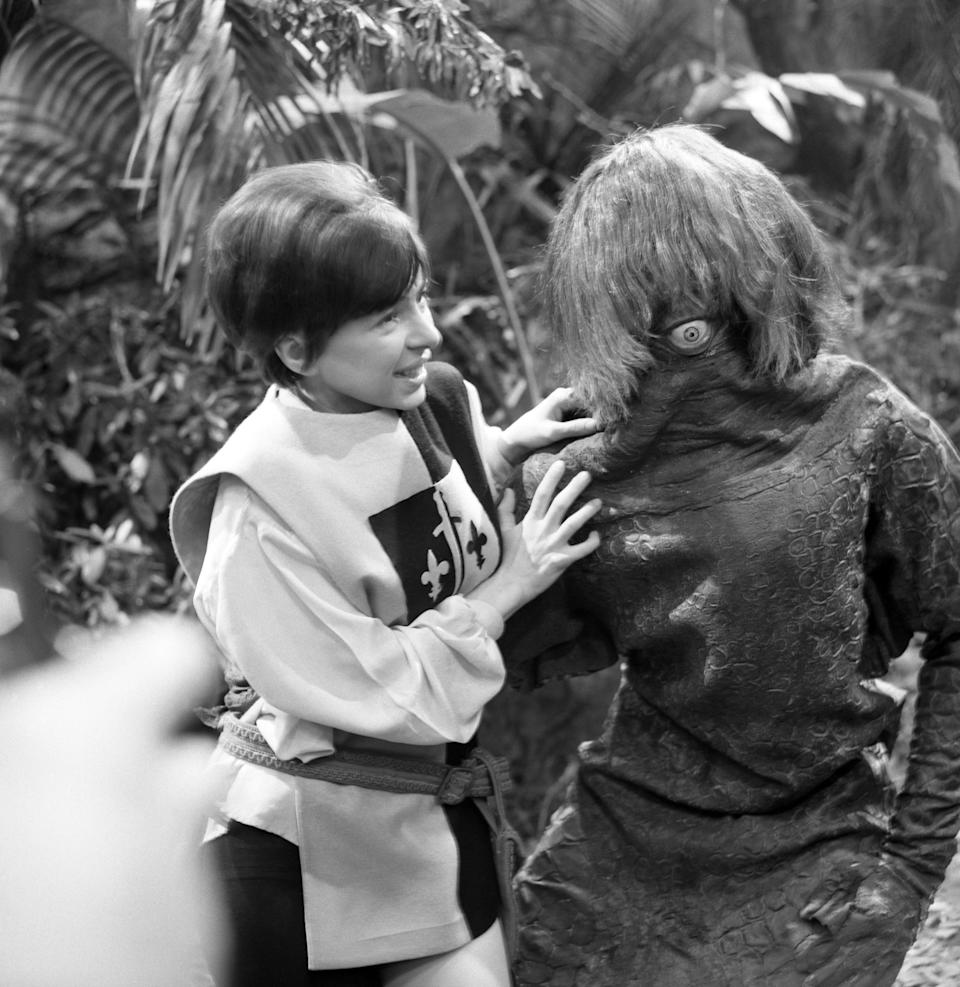 Actress Jackie Lane, who plays new assistant Dodo in the sci-fi series Doctor Who. She is pictured with a Monoid monster (played by Raymond Byrom), a reptilian one-eyed race of sub-humans.   (Photo by PA Images via Getty Images)