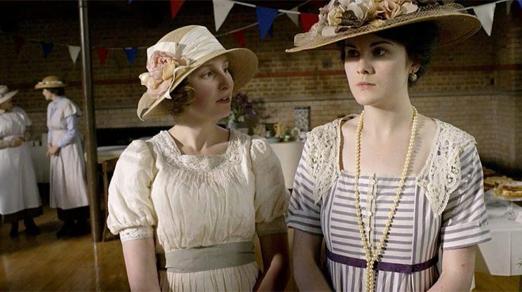 Laura Carmichael as Lady Edith Crawley and Michelle Dockery as Lady Mary Crawley in PBS's Downton Abbey. (Photo Credit: MASTERPIECE/PBS)