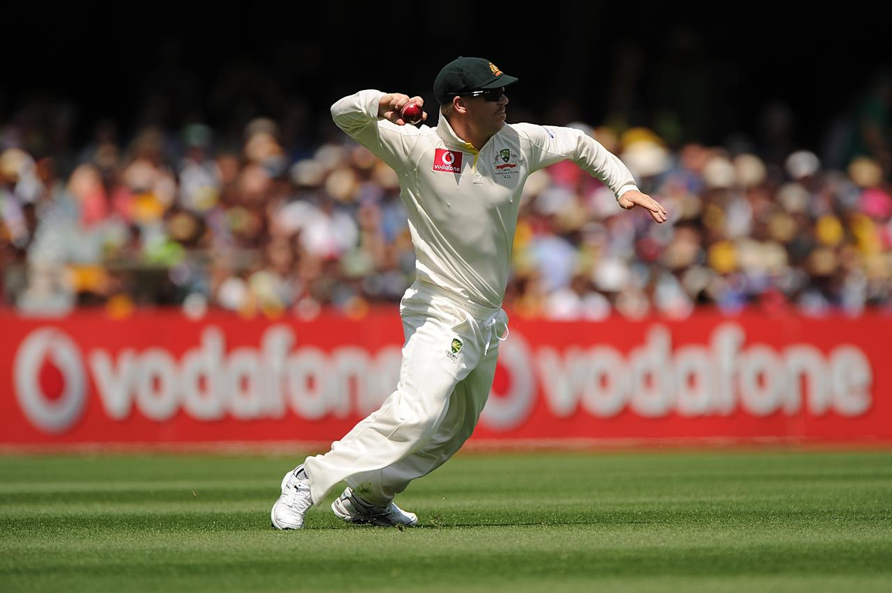 BRISBANE, AUSTRALIA - NOVEMBER 09:  David Warner of Australia fields the ball during day one of the First Test match between Australia and South Africa at The Gabba on November 9, 2012 in Brisbane, Australia.  (Photo by Matt Roberts/Getty Images)
