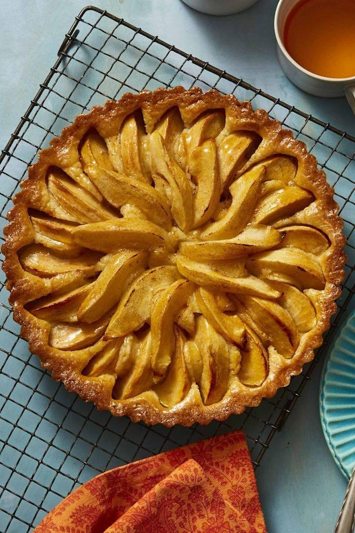 """<p>When you think of all things American, apple pie comes to mind. Step up your apple pie game with this low-cost apple and pear tart.</p><p><em><strong><a href=""""https://www.womansday.com/food-recipes/food-drinks/a26345473/apple-and-pear-tart-recipe/"""" rel=""""nofollow noopener"""" target=""""_blank"""" data-ylk=""""slk:Get the Apple and Pear Tart recipe."""" class=""""link rapid-noclick-resp"""">Get the Apple and Pear Tart recipe.</a></strong></em></p>"""
