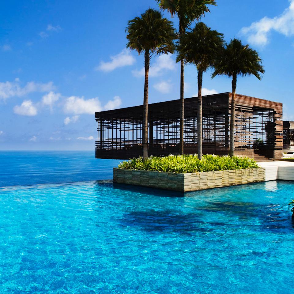 "<p>Being on your honeymoon provides thrills enough, but the gorgeous, gleaming pool at the premier <a rel=""nofollow"" href=""https://www.alilahotels.com/uluwatu?mbid=synd_yahootravel"">Alila Villas</a> resort in Uluwatu—on Bali's southwestern tip—only adds more. It's perched more than 325 feet high, atop the cliff near the island's most iconic surf break, and it not only has space for you to swim laps and laze in the sun, but the Sunset Cabana hanging off the side of it is one of the world's most picturesque places to sip a drink, practice yoga, or renew your vows.</p>"