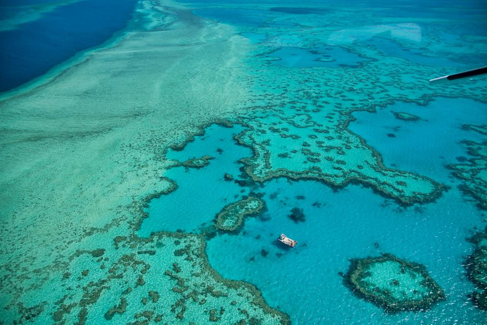 Natural Great Barrier Reef in Queensland. Aerial view of nature paradise with magnificent colors.. (Photo by: Gagliardi Giovanni /REDA&CO/Universal Images Group via Getty Images)