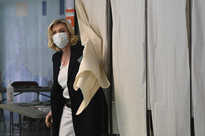 French far-right leader Marine Le Pen leaves the voting booth before voting for the regional elections in Henin-Beaumont, northern France, Sunday, June 20, 2021. Marine Le Pen's far right party is riding high on her tough-on-security, stop-immigration message as French voters start choosing regional leaders Sunday in an election that's seen as a dress rehearsal for next year's presidential vote. (AP Photo)