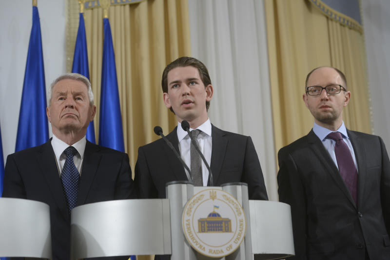 Austrian Foreign Minister Sebastian Kurz, center, Ukrainian Prime Minister Arseniy Yatsenyuk, right, and Secretary-General of the Council of Europe Thorbjorn Jagland address to media in Kiev, Ukraine, Monday, March, 10, 2014. (AP Photo/Andrew Kravchenko, pool)