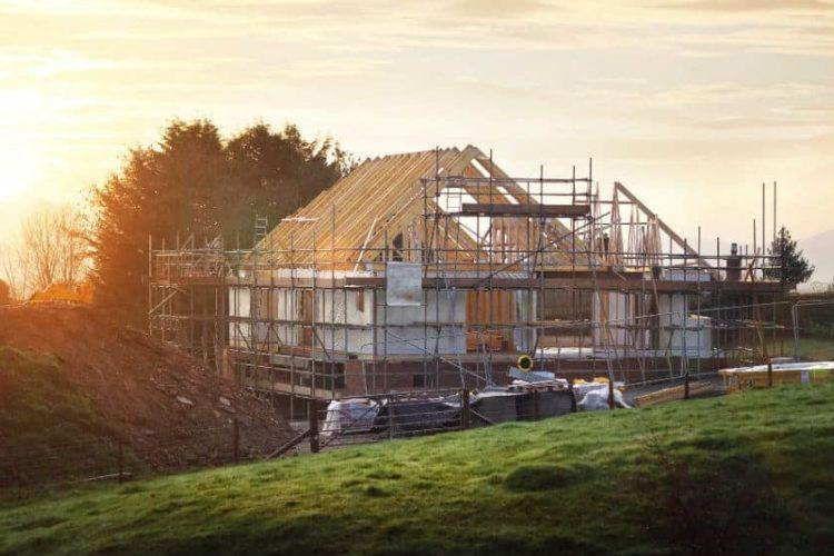 A house being constructed in the countryside