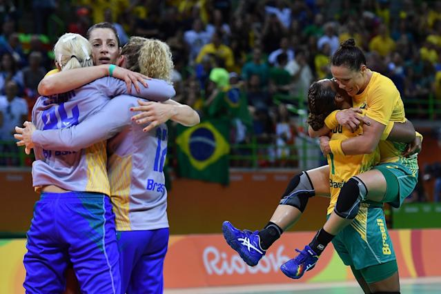 <p>Brazilian players celebrate their victory at the end of the women's preliminaries Group A handball match Norway vs Brazil on Day 1 of the Rio 2016 Olympic Games at Future Arena on August 6, 2016 in Rio de Janeiro, Brazil. (Photo by Pascal Le Segretain/Getty Images) </p>
