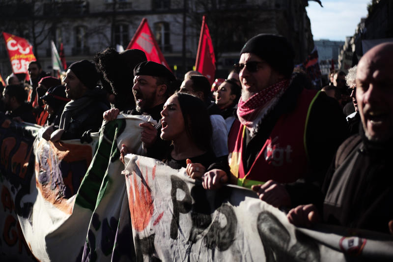 Protesters shout during a demonstration Thursday, Jan. 16, 2020 in Paris. Protesters denounce French President Emmanuel Macron's plans to overhaul the pension system. (AP Photo/Kamil Zihnioglu)