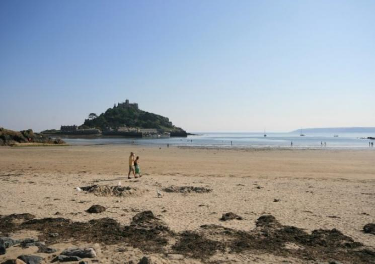 <p>Though often overshadowed by the nearby island village of St. Michael's Mount, Marazion beach provides beautiful views of the mount as well as a sandy spot for building sandcastles, swimming or exploring rock pools at low tide. The nearby Marazion village has plenty of shops and restaurants, and of course St. Michael's Mount can be explored via a small causeway at low tide, or by boat at high tide.</p><p><strong>Don't Miss</strong>: Couples may seek to summit St. Michael's Mount for panoramas of the sea as well as a chance to touch the highest point of the Mount's bedrock. Cornish lore says romantic wishes made while touching this rock will be granted.</p>