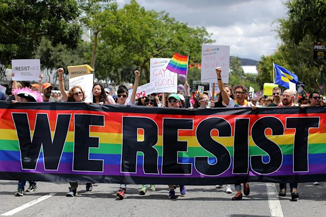 <p>The annual Pride Parade is replaced with a Resist March as members of the LGBT community protest President Donald Trump in West Hollywood, Calif., on June 11, 2017. (Photo: Mike Blake/Reuters) </p>