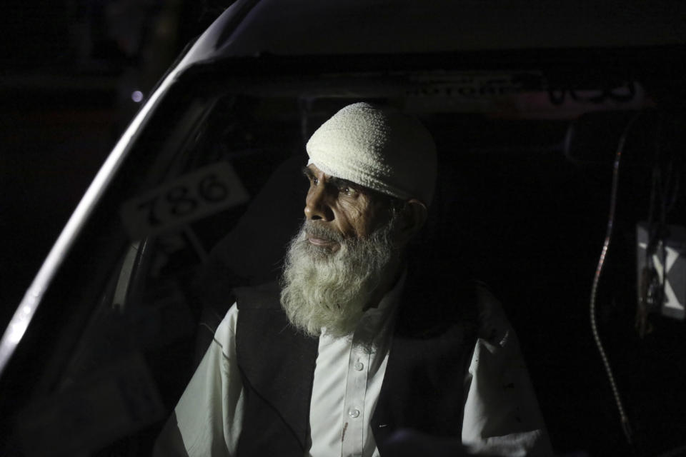 An injured man sits in a car waiting to go to a hospital in Kabul, Afghanistan, Friday, April 30, 2021. A powerful suicide truck bombing struck a guest house in eastern Afghanistan on Friday, killing at least 14 people and wounding as many as 90, the Interior Ministry said. (AP Photo/Rahmat Gul)