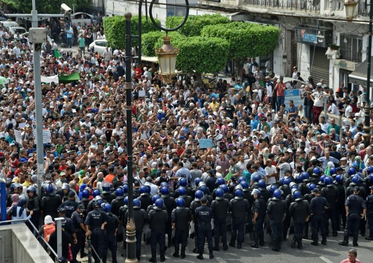 Police detained at least 10 protesters during Tuesday's protests, said an AFP journalist (AFP Photo/RYAD KRAMDI                        )