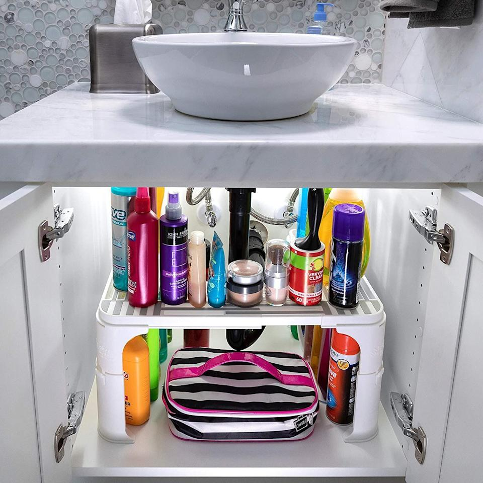 "Why is it that everyone's under-sink cabinet looks like a disaster zone? Organize it once and for all with <a href=""https://amzn.to/3jTZ0LD"" target=""_blank"" rel=""noopener noreferrer"">this expandable under-sink organizer</a>. If your kitchen cabinets are deep enough, you could even use this to organize dry goods, canned foods and even Tupperware and food storage lids in the kitchen. Normally $30, <a href=""https://amzn.to/3jTZ0LD"" target=""_blank"" rel=""noopener noreferrer"">get it on sale for $20</a> on Cyber Monday on Amazon."