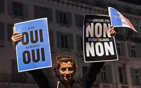 Marches took place on Tuesday night across France - Credit: BORIS HORVAT/AFP/Getty Images
