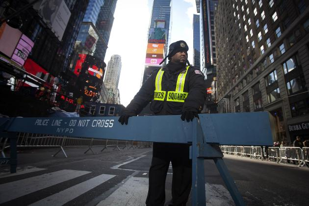 CLICK IMAGE for slideshow: A security guard stands in Times Square as streets are closed in preparation for New Year's Eve celebrations in New York December 31, 2014. (REUTERS/Carlo Allegri)